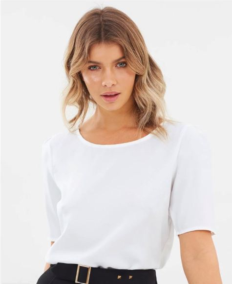 blonde white female modelling a white top