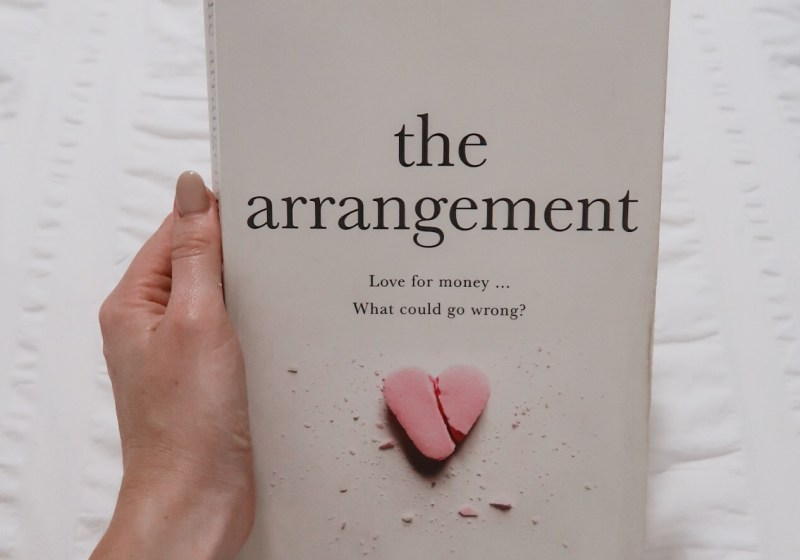 Front cover of the novel called The Arrangement