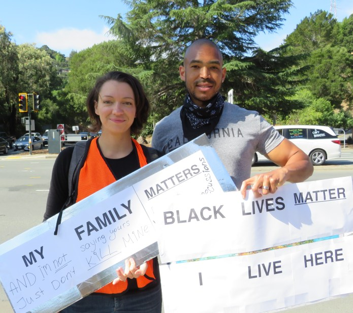 (Kathy Enzerink, Photographer)Protest organizers and Orinda residents Tatiana and Neil Pretlow