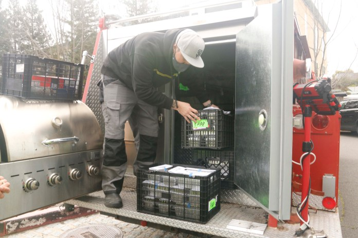 (Copyright Lori A. Cheung)Bo Galindo Unloading Fire Truck