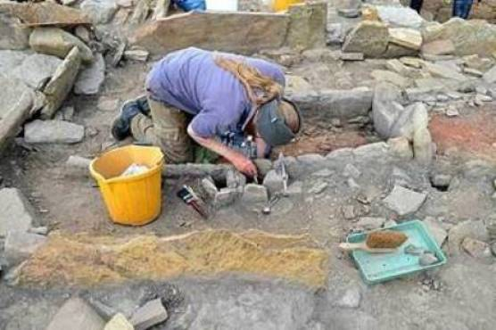 The Cairns excavating the large hearth located in the Wag Structure