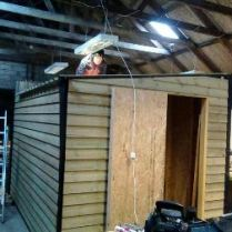 Tim stitching the roof, building a shed for Orkney charity shop The Blue Door in 2018