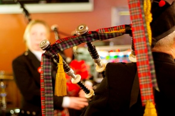 The Rendall Pipe Band in the Auld Motor Hoose by Martin Laird ON
