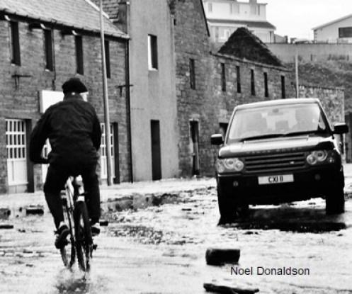 2012 flooding man on bike