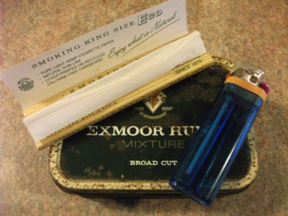 tobacco tin and roll ups Bernie Bell