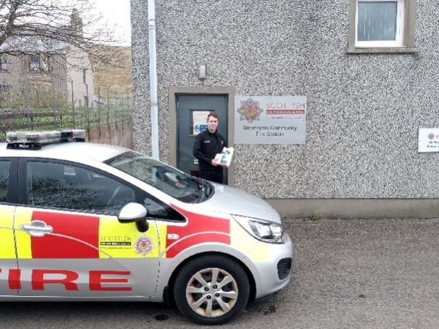 Stromness Firefighter Ross Harvey with prescriptions picked up from local chemist