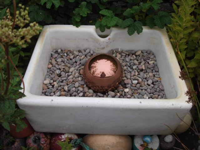 sink in garden with shiny ball in it credit: Bell