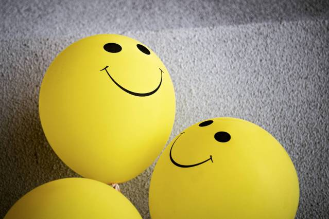yellow smiley emoji on gray surface