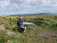 Mike Bell at picnic bench Birsay Moors credit Bell