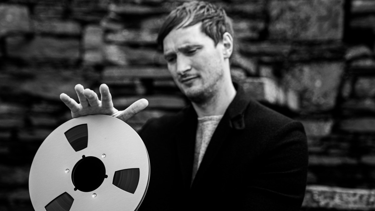 Erlend Cooper with a reel to reel tape.