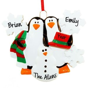 Penguins making a snowman