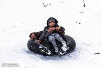 Iran, North Khorasan province, Mahnan village near Bojnourd Families Sliding on Snow 02