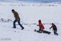Iran, North Khorasan province, Mahnan village near Bojnourd Families Sliding on Snow 05