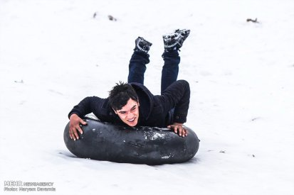 Iran, North Khorasan province, Mahnan village near Bojnourd Families Sliding on Snow 08