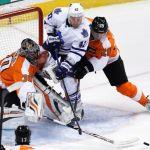 Flyers goalie Bryzgalov pokes the puck away