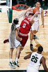 Indiana's Will Sheehey shoots against Michigan State's Travis Trice