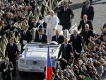 Pope Francis waves to the crowd as he rides through St. Peter's Square