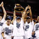 UConn's Kelly Faris holds aloft the trophy as she and her teammates celebrate their victory