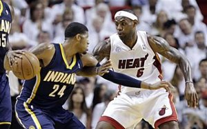 LeBron James defends against Paul George