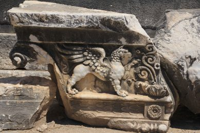 Carvings of lions and griffins lines the walls.