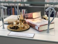"There are little displays among the shelves ""illustrating"" the books."