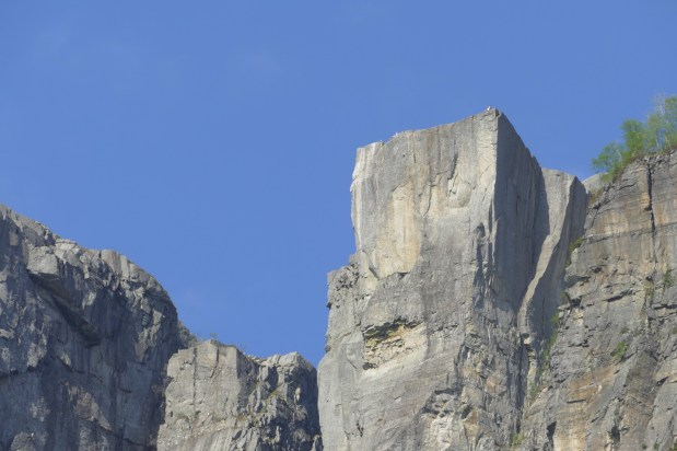 Look closely & you can see a couple of people on the edge of the rock. Their size gives an indication of their height.