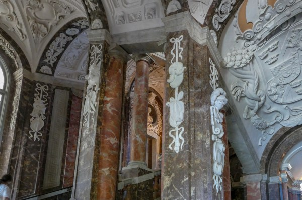 The entrance is very grand, with lots of faux marble, paintings & stucco work.