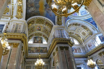 The walls and ceiling are decorated with detailed paintings and mosaics, and lots of gold.