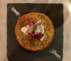 Chickpea pancake with stracciatella cheese, red onion and steamed mackerel.