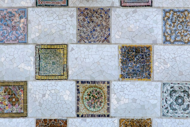 Trencadís is a technique used to cover structures with a mosaic, normally abstract, of irregular pieces of ceramic, glass or marble tiles and even broken china, buttons or shells, popularised by the Catalonian Modernist architects.