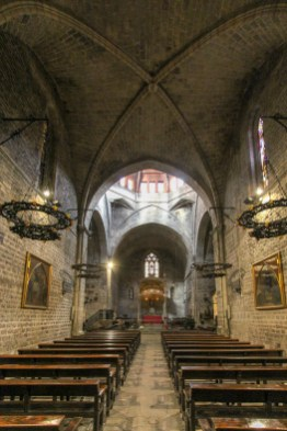 The simple interior of the church, in Catalan Gothic style.