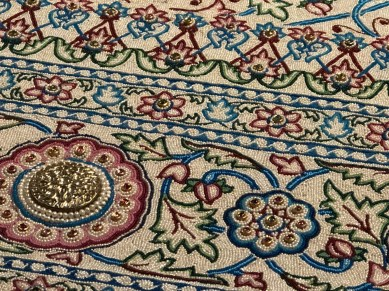 "A close up of the Pearl Carpet of Baroda ""the most extravagant carpet ever made"". Made in 1865 to cover the tomb of Mohammed. It has over 1 million seed pearls, as well as rubies, emeralds, diamonds and sapphires."