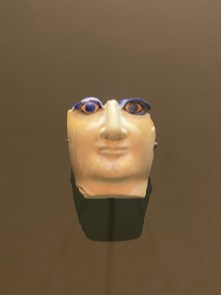 Limestone or marble head from a composite statue with inlaid eyes of shell and lapis lazuli. Mesopotamia ca 2550 to 2350 BCE