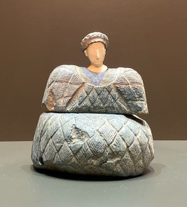 Stone sculpture of a seated female with finely carved features. Bactria-Margiana, Late 3rd to early 2nd millennium BCE