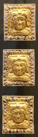 Gold plaques with enamel decoration framing the bust of Heracles. Probably belt strap fittings Central Asia or Black Sea region, Hellenistic period. ca. 2nd century BCE.