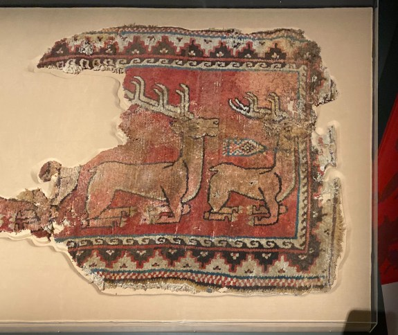Fragmentary wool pile carpet with the mythical griffin. Bactria, Sasanian period, ca. 265-315 CE