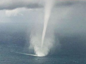 Notice the wake behind the Waterspout
