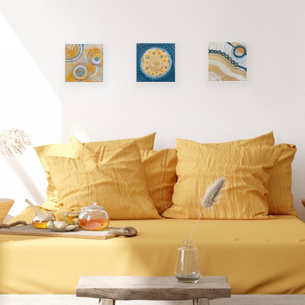 set of 3 abstract paintings above bed
