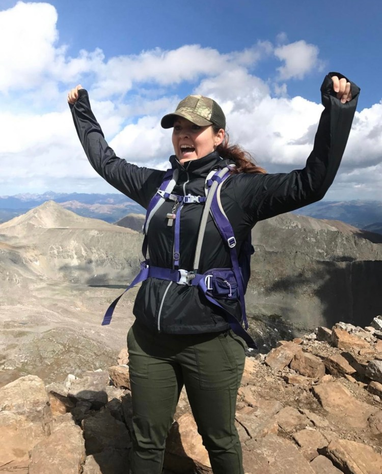 Celebrating at the summit of Quandary Peak, my first 14er