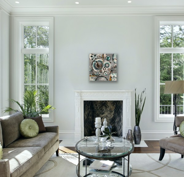 Abstract mixed media painting above fireplace