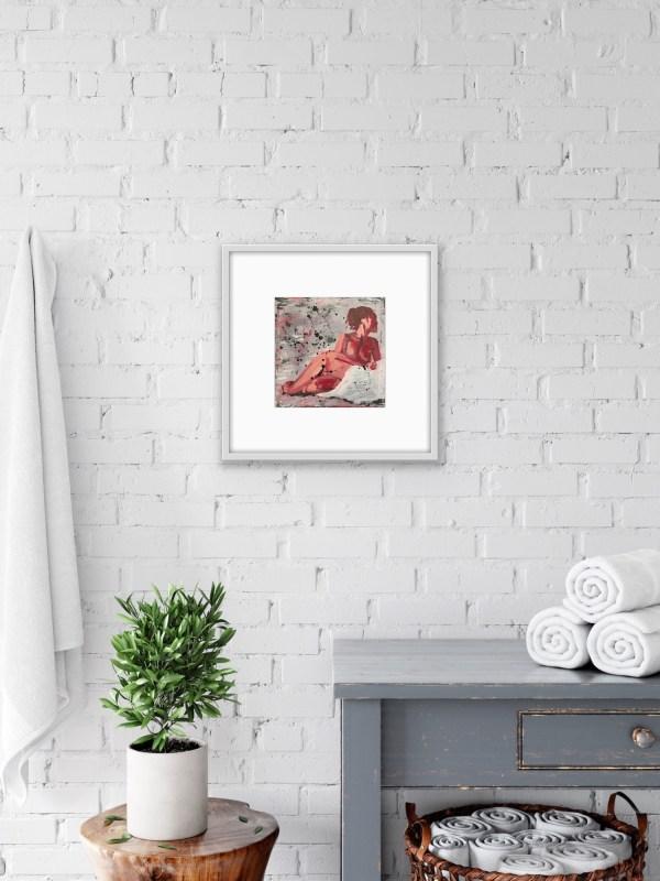 framed figure painting in bathroom