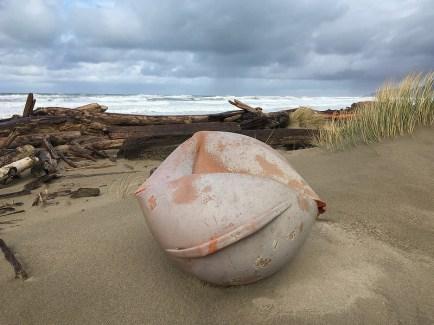 Large buoy at the base of the foredune
