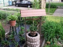 Wishing Well Planter Made From Recycled Tires The Owner Builder Network
