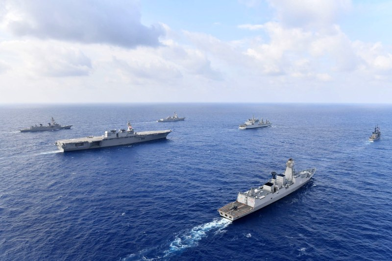 Boats from the U.S. Pacific Fleet in the South China Sea under a blue sky.