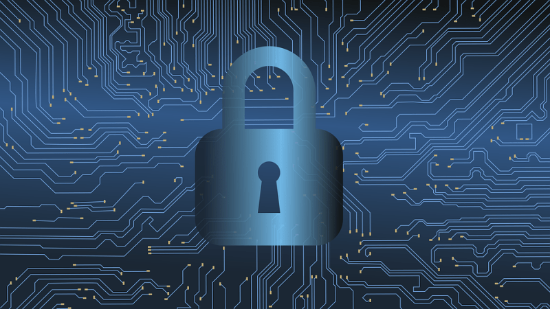 A lock icon is superimposed on a circuitboard pattern. The image is rendered in shades of blue.