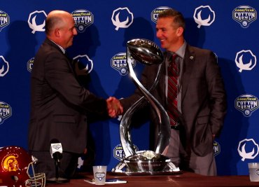 Urban Meyer and Clay Helton