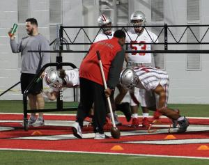 Nick Bosa and Tommy Togiai work under the watchful eye of Larry Johnson