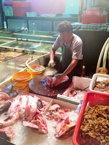 Cleaning and deboning fish on the streets of Cheung Chau