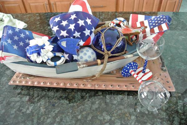 boat with napkins centerpiece thepaintedapron.com
