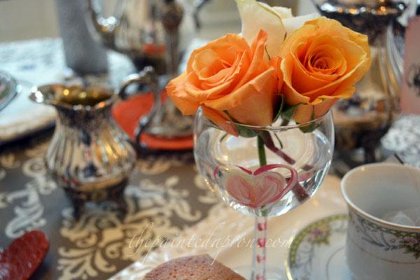 roses in wine glass thepaintedapron.com